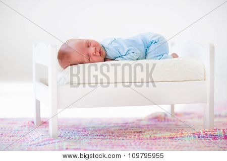 Little Baby Sleeping In Toy Bed