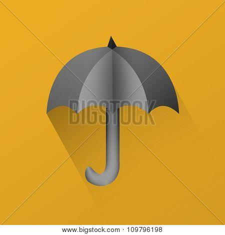 Black umbrella with long shadow