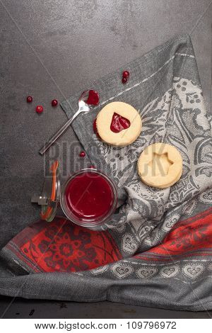 Lemon and ginger biscuits with cranberry jam. Top view