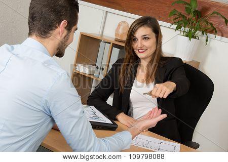 Female Broker Giving Man Key From New Flat