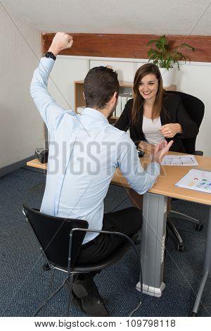 Business Man Showing Hands Up At Desk