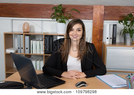 Portrait Of Serious Business Woman At Work In A Bright Office