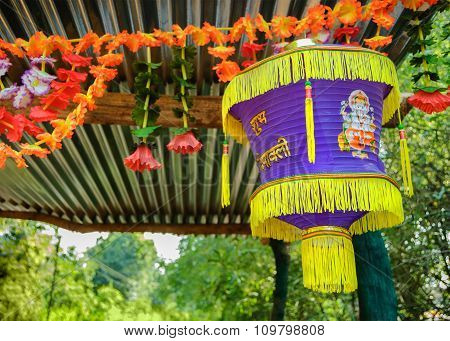 Indian lantern. Big colorful lanterns and beautiful flowers will bring good luck and peace to prayer during Happy Divali