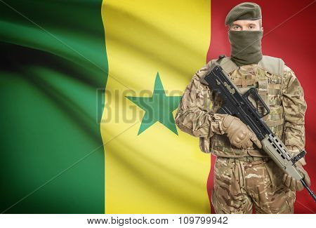Soldier Holding Machine Gun With Flag On Background Series - Senegal