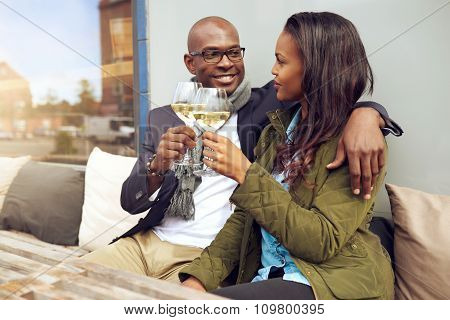 Happy Young Couple Enjoying A Romantic Drink