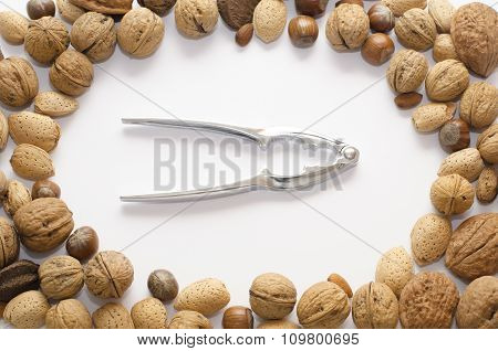 Nutcracker in a middle of circle from nuts on a isolated background