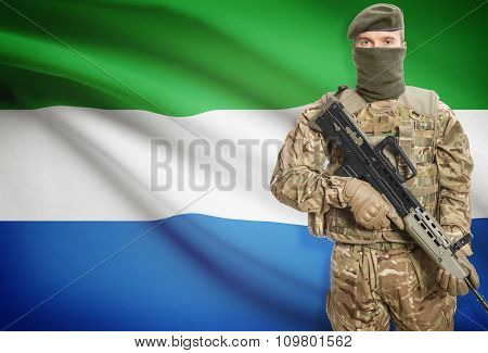 Soldier Holding Machine Gun With Flag On Background Series - Sierra Leone