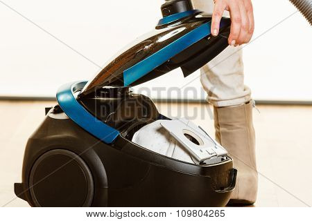 Woman Opening Vacuum Cleaner.