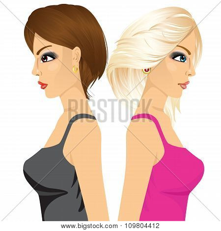 two woman standing with back to back