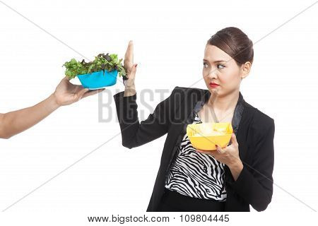 Young Asian Woman With Potato Chips Say No To Salad