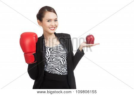 Young Asian Business Woman With Red Apple And Boxing Glove