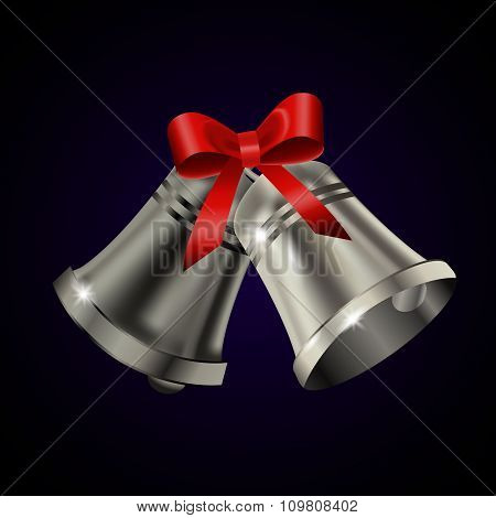 Silver bells with red bow