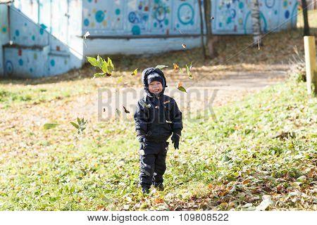 Happy Boy In Autumn Park.
