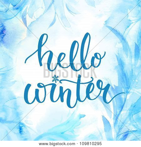 Hello winter banner with lettering, brush script at blue watercolor frosty background. Winter season