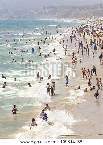 Beach full of people during peak season.
