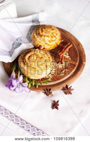 bun with cinnamon on board rustic, rural, top, sweet, snail