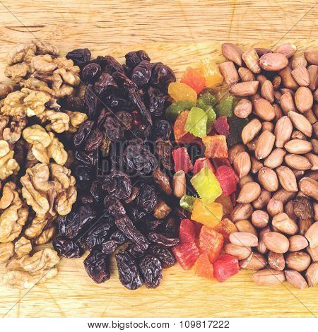 Mix Of Nuts And Dry Fruits On Wooden Background