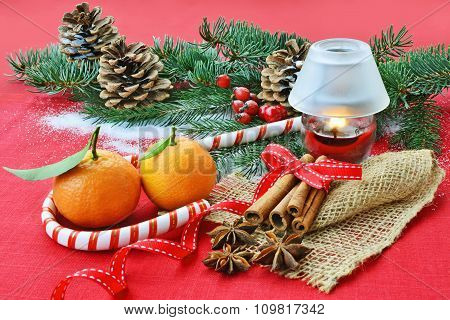 Red Christmas Background With Fruits, Spices, Fir, Cone, Candle Lantern