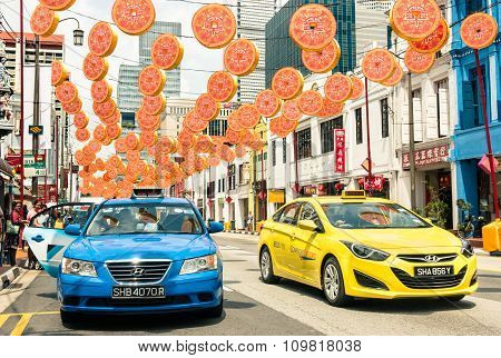 Singapore - February 12, 2015: Multicolored Taxi Cabs Driving On South Bridge Road