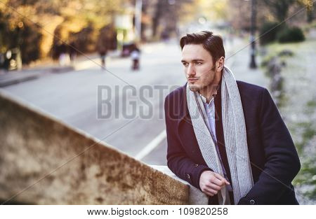 Handsome young man outdoor in winter fashion