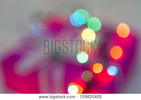 Defocused Christmas Lights And Gift Background