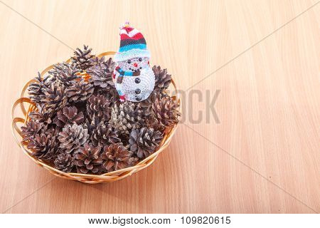 Stack Of Evergreen Pinecones And Silver Start
