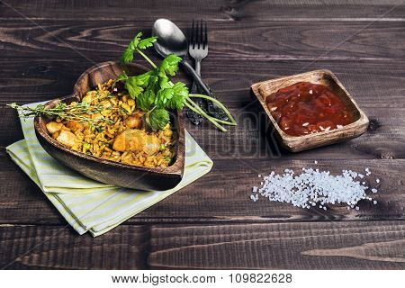 Paella On A Wooden Table