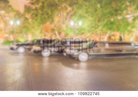 Defocused Background Of 3 Black Luxury Limos
