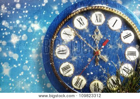 Snow-covered Clock On  Blue Background