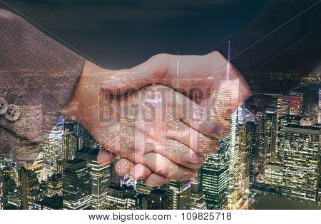 Hand Shake And Urban Background