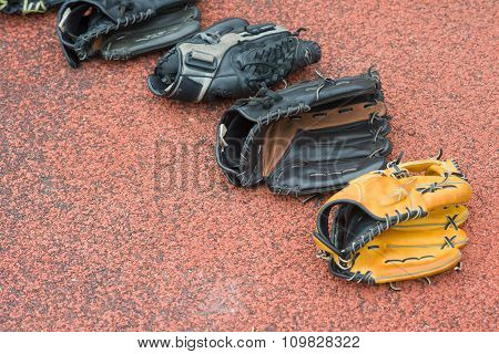 Baseball Gloves On A Rubber Background