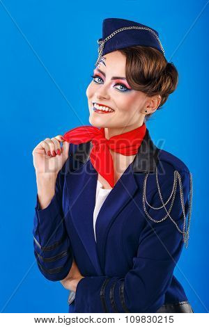 Stewardess With Face Art Corrects Neckerchief.