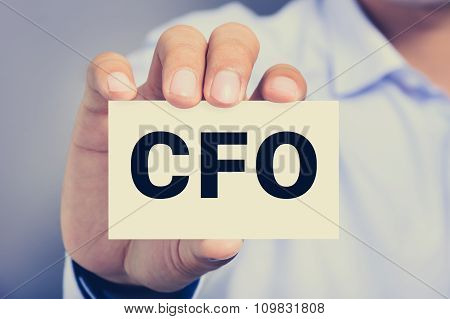 Cfo Letters (or Chief Financial Officer) On The Card Held By A Man Hand