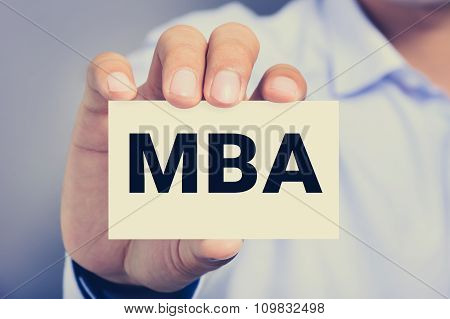 Mba Letters (or Master Of Business Administration) On The Card Held By A Man Hand