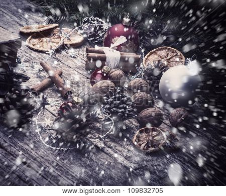Festive Gifts with Boxes, Cinnamon Sticks, Dried Oranges, Baubles, Cones, Walnuts.