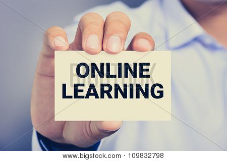 Online Learning, Messasge On The Card Shown By A Man