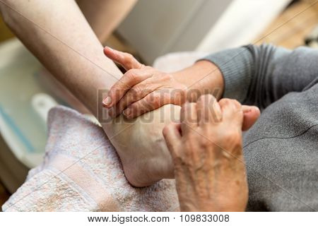 Podologist At A Foot Reflexology