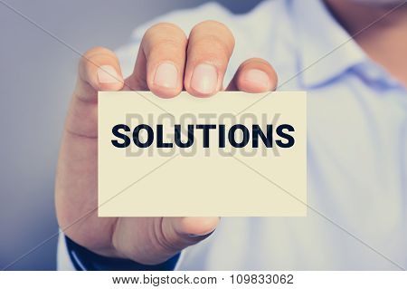A Man Showing Card With Solutions Word