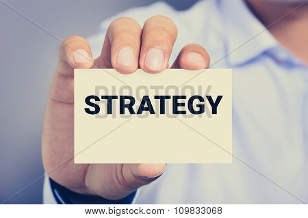A Man Showing Card With Strategy Word