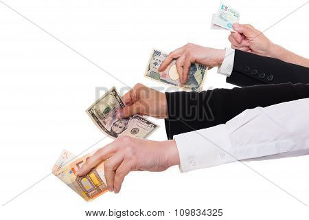 Four Different Hands With Important Currencies