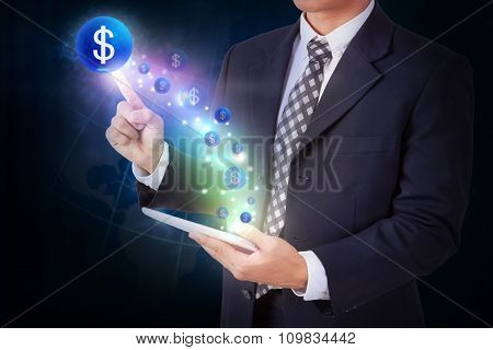 Businessman holding tablet with pressing dollar sign icon button. internet and networking concept