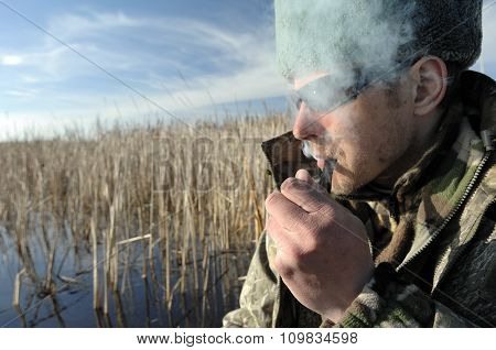 Fisherman With sunglasses Is Smoking Tobacco-pipe
