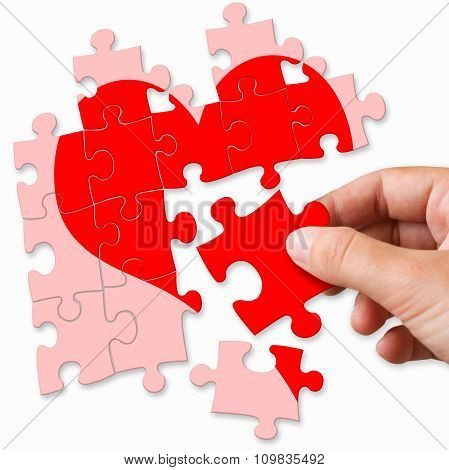 Red Broken Heart Made By Puzzle Pieces