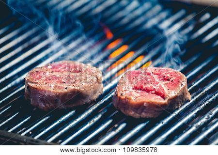 Delicious steak on the grill close up