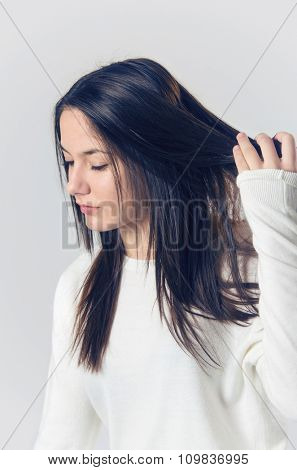 Young teenager brunette girl candid studio portrait