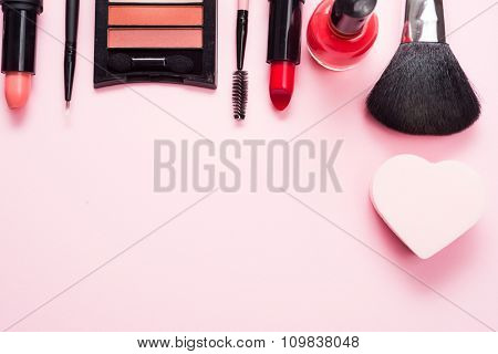 Make-up products on a pink table