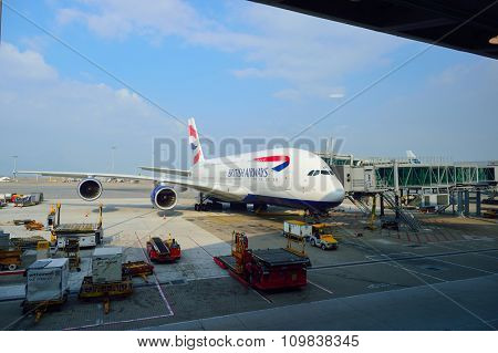 HONG KONG - NOVEMBER 22, 2015: jet flight docked in Hong Kong Airport. Hong Kong International Airport is the main airport in Hong Kong. It is located on the island of Chek Lap Kok