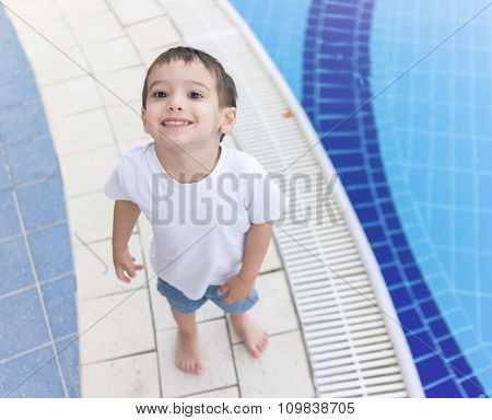 3 years old boy on resort pool enjoying
