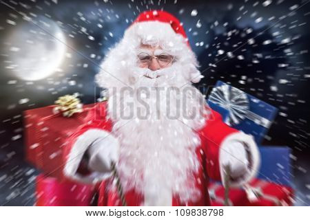 Santa Claus riding his sled in the Christmas night to deliver the presents