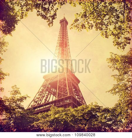 View of Eiffel tower in Paris at sunset in grunge style.